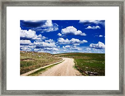Into The Clouds Framed Print by Eric Benjamin