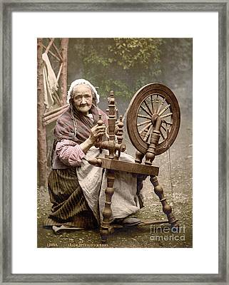 Irish Spinner And Spinning Wheel, 1890s Framed Print by Science Source