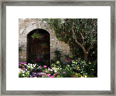 Italian Front Door Adorned With Flowers Framed Print by Marilyn Hunt