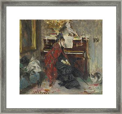 Italian Woman At The Piano Framed Print by Giovanni Boldini