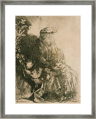 Jacob Caressing Benjamin Framed Print by Rembrandt