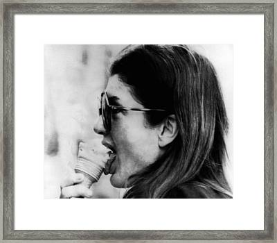 Jacqueline Kennedy Onassis Licks An Ice Framed Print by Everett