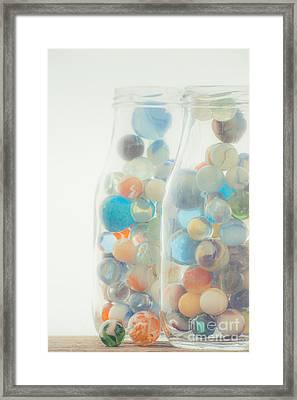 Jars Full Of Marbles Framed Print by Edward Fielding