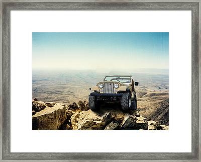 Jeep On A Mountain Framed Print by Brian Kinney