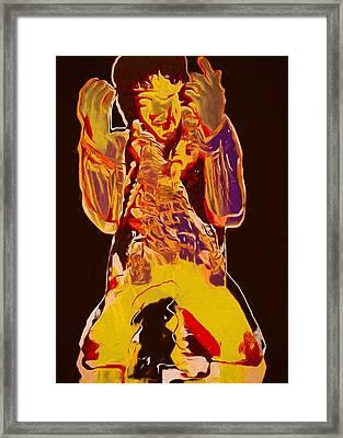 Jimi Setting Guitar On Fire Framed Print by Dan Sproul