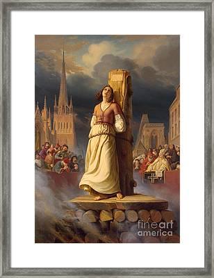 Joan Of Arc's Death At The Stake Framed Print by Hermann Anton Stilke
