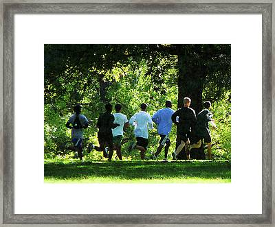 Joggers In The Park Framed Print by Susan Savad