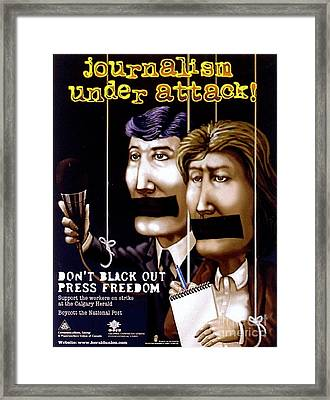 Journalism Under Attack Framed Print by Armand Roy