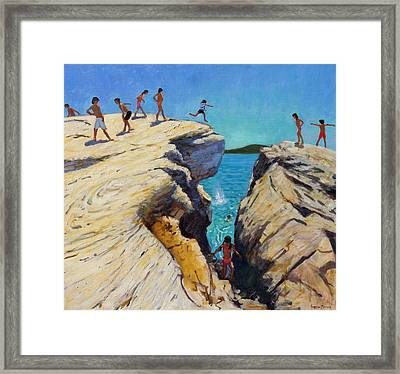 Jumping Off The Rocks Framed Print by Andrew Macara