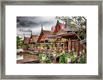 Kanchanaburi River Shops Framed Print by Adrian Evans