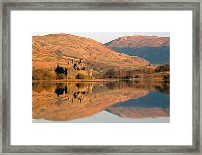 Kilchurn Castle In Autumn Framed Print by John McKinlay