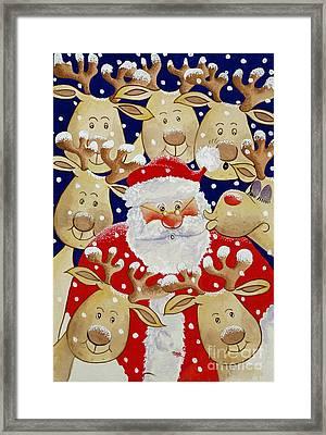 Kiss For Santa Framed Print by Tony Todd
