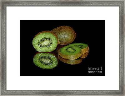 Kiwi Fruit Reflecting On Black By Kaye Menner Framed Print by Kaye Menner