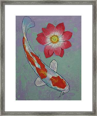 Koi And Lotus Framed Print by Michael Creese