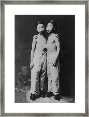 Korean Siamese Twins Standing Framed Print by Everett