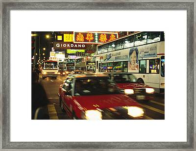 Kowloon Street Scene At Night With Neon Framed Print by Justin Guariglia