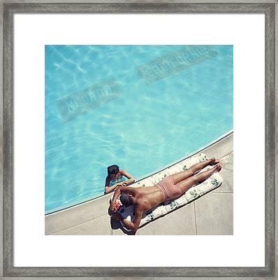 Lake Tahoe Couple Framed Print by Slim Aarons