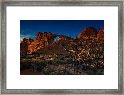 Last Light At Skyline Arch Framed Print by Rick Berk