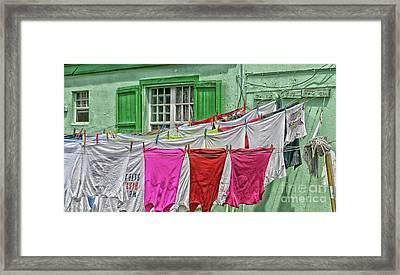 Laundry Day Framed Print by Arnie Goldstein