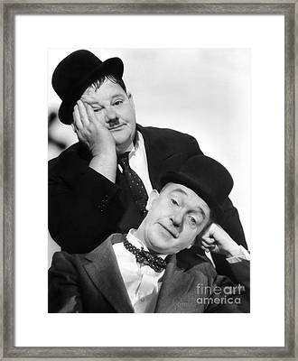 Laurel And Hardy, 1939 Framed Print by Granger