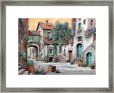 Le Scale Tra Le Case Framed Print by Guido Borelli