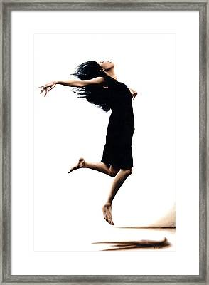 Leap Into The Unknown Framed Print by Richard Young
