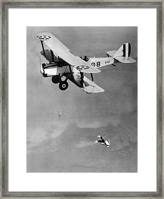 Leaping From Army Airplane Framed Print by Underwood Archives