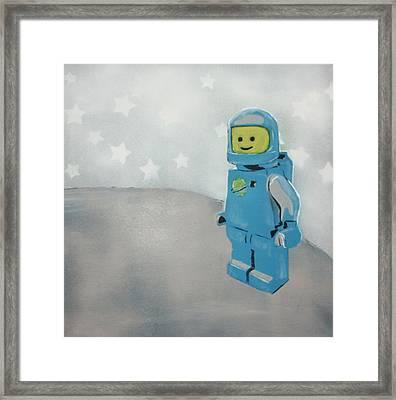 Lego Man On The Moon Framed Print by Wall Kandi