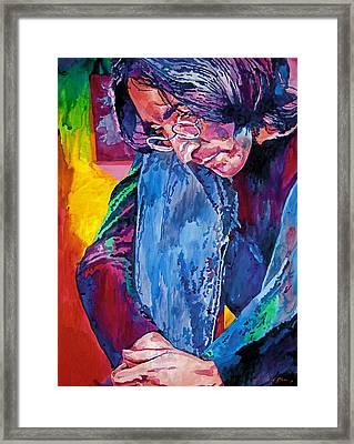 Lennon In Repose Framed Print by David Lloyd Glover