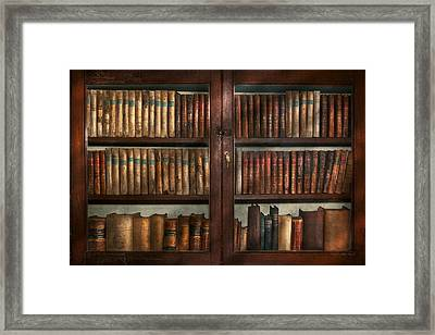 Librarian - In The Library Framed Print by Mike Savad