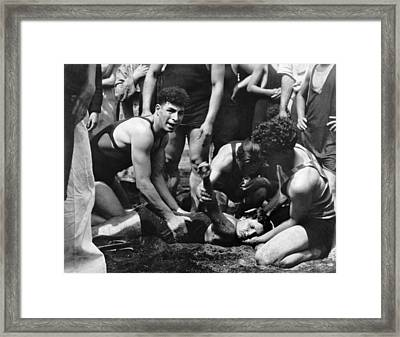 Lifeguard Resuscitating Woman Framed Print by Underwood Archives