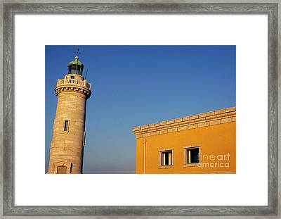 Lighthouse And Yellow Building At The Entrance Of The Port Of Marseille Framed Print by Sami Sarkis
