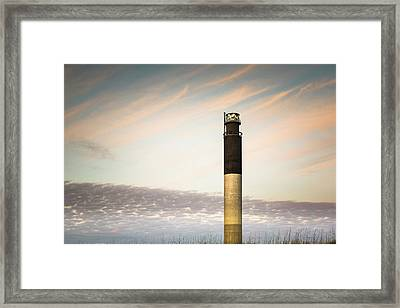 Lighthouse In The Clouds Framed Print by Ivo Kerssemakers