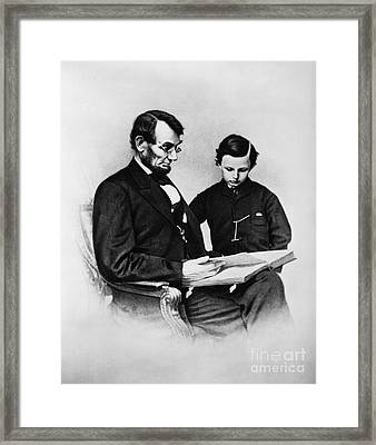 Lincoln Reading To His Son Framed Print by Photo Researchers