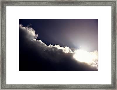 Lingering Storm Clouds Violet Cast Framed Print by Linda Brody