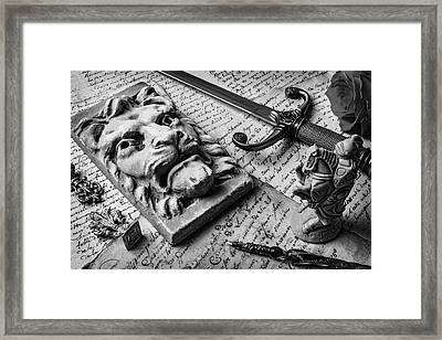 Lion And Dagger In Black And White Framed Print by Garry Gay