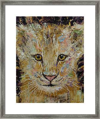 Lion Cub Framed Print by Michael Creese