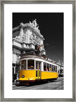 Lisbon's Typical Yellow Tram In Commerce Square Framed Print by Jose Elias - Sofia Pereira