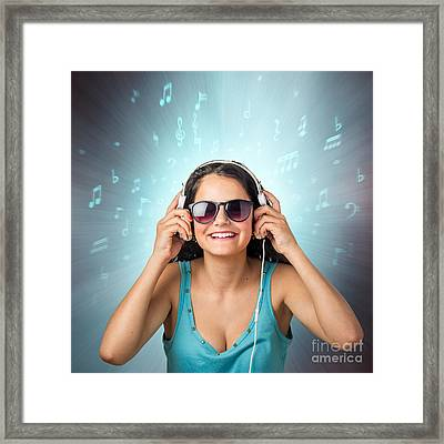 Listening With Headset Framed Print by Carlos Caetano