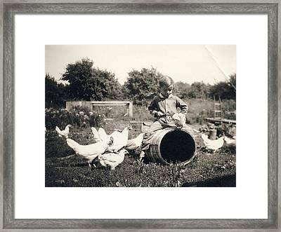 Little Boy Feeding Chicken Framed Print by MotionAge Designs
