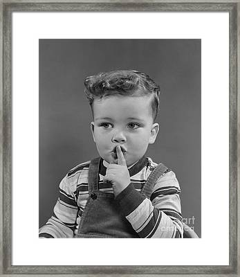 Little Boy Making Shushing Gesture Framed Print by H. Armstrong Roberts/ClassicStock