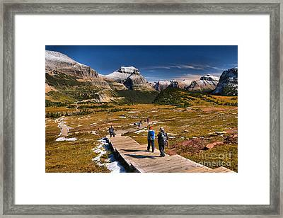 Logan Pass Hikers Framed Print by Adam Jewell