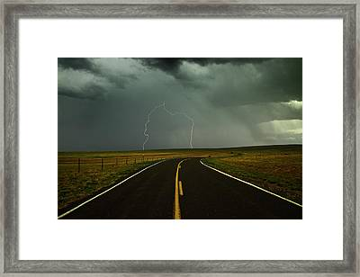 Long And Winding Road Against Lighting Strike Framed Print by DaveArnoldPhoto.com