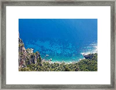 Looking Down Cliff Onto Mediterranean Sea Framed Print by Susan Schmitz