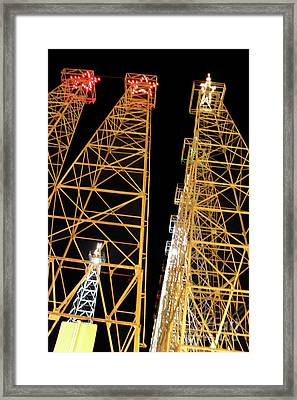 Looking Up At The Kilgore Lighted Derricks Framed Print by Kathy  White