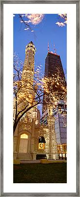 Low Angle View Of An Illumined Tower Framed Print by Panoramic Images