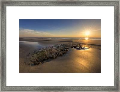 Low Tides Framed Print by Debra and Dave Vanderlaan
