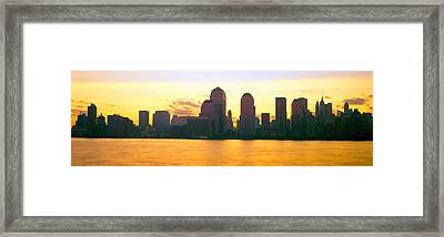 Lower Manhattan Skyline At Sunrise Framed Print by Panoramic Images
