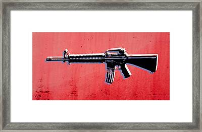 M16 Assault Rifle On Red Framed Print by Michael Tompsett