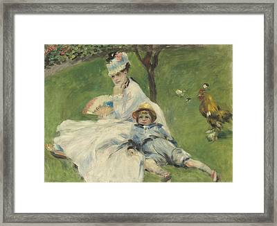 Madame Monet And Her Son Framed Print by Pierre Auguste Renoir
